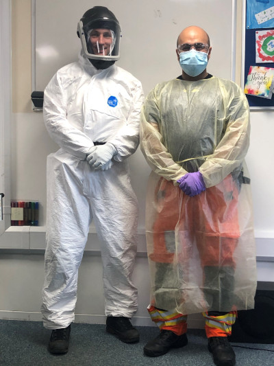 Paramedic Nigel Strange and Dr Rishi Rallan demonstrating the new PPE